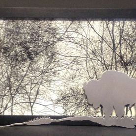 Metal art, bison and forest